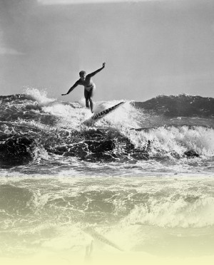 A North Bondi lifesaver on surfboard, J Fitzpatrick, 1950.++