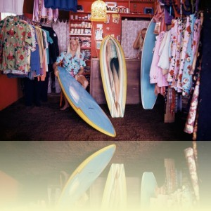 Russell Lewis in Henri Surf Shop, Curl Curl, late 1970s. Photograph courtesy and © Hugh McLeod/Aitionn++