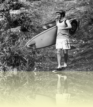 Surfer with board, Bruce Usher, c1970. Courtesy and © Bruce Usher++